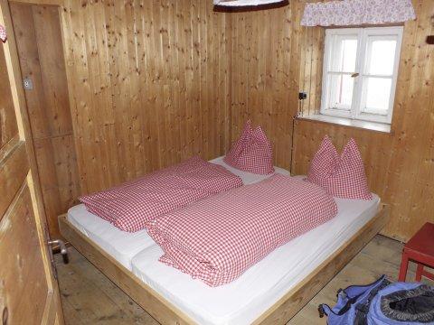 Gemütliches Zimmer auf der Schöne Aussicht Hütte.