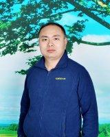 Junwen Chu Reiseleiter-Porträt'