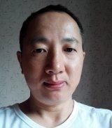Hongquan Dong Reiseleiter-Porträt'