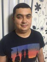 Azamat Azizov Reiseleiter-Porträt'